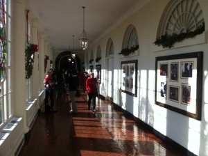 Walk through the East Colonnade where the Kennedy Gardens are visible through the windows lining the hall